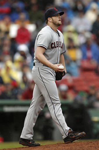 Cleveland Indians relief pitcher Vinnie Pestano walks back to the mound after giving up the go-ahead double to Boston Red Sox's Dustin Pedroia during the eighth inning of their 7-4 loss in a baseball game at Fenway Park in Boston, Saturday, May 25, 2013. (AP Photo/Winslow Townson)