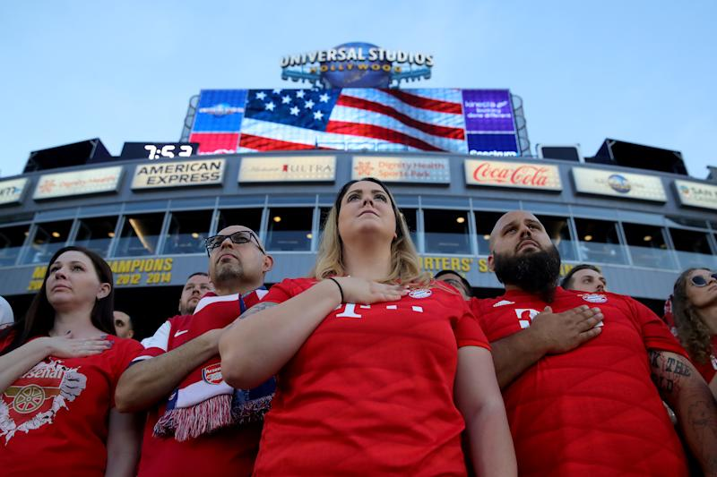 CARSON, CALIFORNIA - JULY 17: Supporters of Bayern Muenchen seen at the national anthem of the USA prior to the 2019 International Champions Cup match between Arsenal London and FC Bayern Muenchen at Dignity Health Sports Park on July 17, 2019 in Carson, California. (Photo by Alexander Hassenstein/Bongarts/Getty Images)