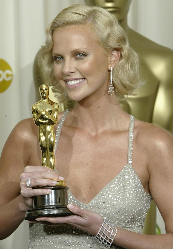 "<p><a class=""sugar-inline-link ga-track"" title=""Latest photos and news for Charlize Theron"" href=""https://www.popsugar.com/Charlize-Theron"" target=""_blank"" data-ga-category=""Related"" data-ga-label=""https://www.popsugar.com/Charlize-Theron"" data-ga-action=""&lt;-related-&gt; Links"">Charlize Theron</a> styled her bob haircut into fingerwaves at the Oscars in 2004. </p>"