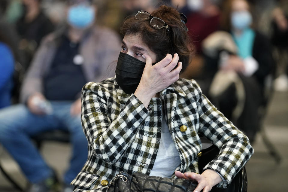 Sylvia Harrison wipes away tears as she listens to live music from a string quartet after receiving a COVID-19 vaccine at the Jacob K. Javits Convention Center, Tuesday, March 23, 2021, in New York. (AP Photo/Kathy Willens)