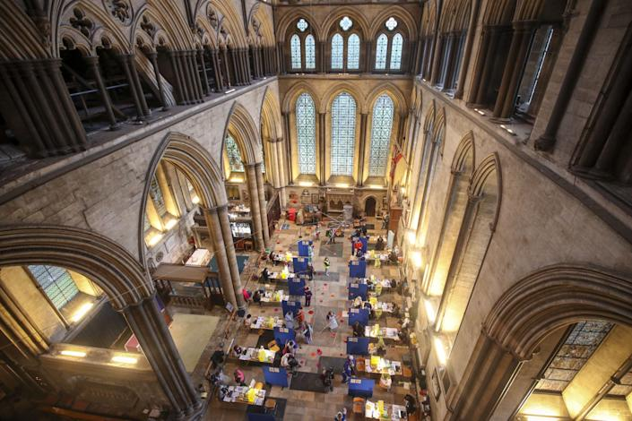 <p>Cubicles erected inside Salisbury Cathedral, Wiltshire, for people to receive an injection of the Pfizer coronavirus vaccine.</p> (PA)