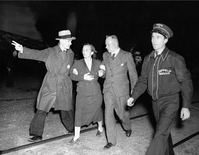 <p>An unidentified woman survivor is being led from the scene of the Hindenburg disaster at the U.S. Naval Station in Lakehurst, N.J., May 6, 1937. (AP Photo/Murray Becker) </p>