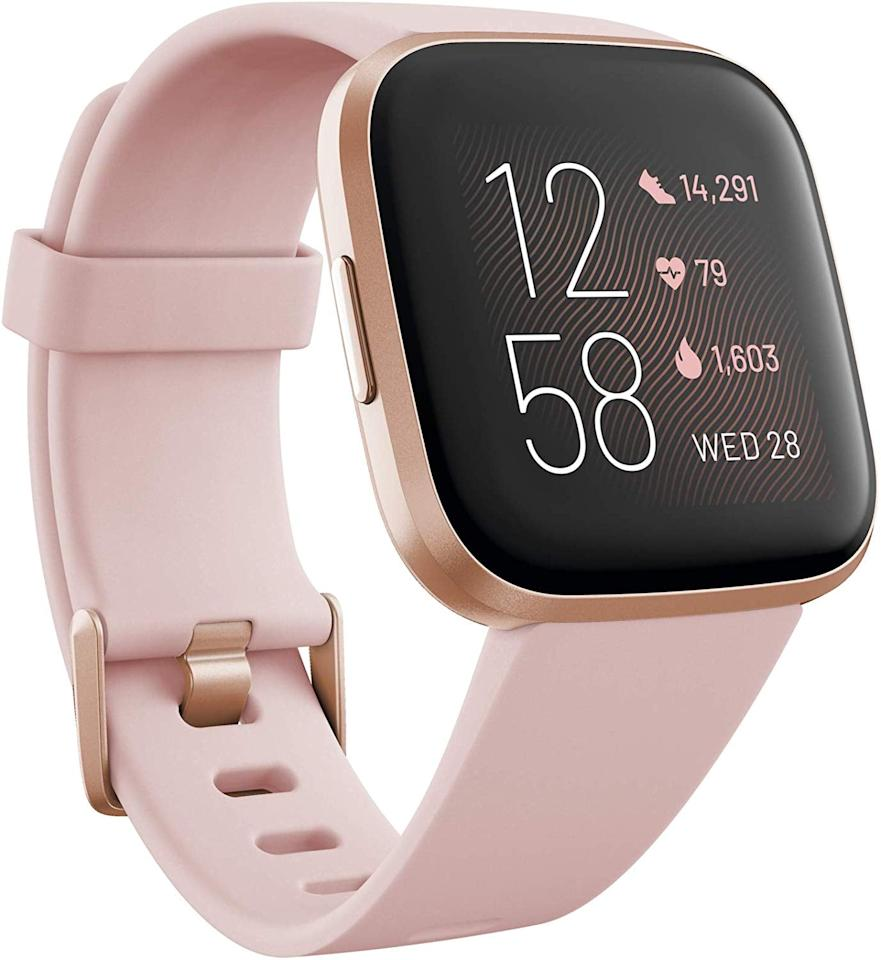 """<p>This pink and rose gold <a href=""""https://www.popsugar.com/buy/Fitbit-Versa-2-Smart-Watch-509795?p_name=Fitbit%20Versa%202%20Smart%20Watch&retailer=amazon.com&pid=509795&price=200&evar1=fit%3Aus&evar9=45429699&evar98=https%3A%2F%2Fwww.popsugar.com%2Ffitness%2Fphoto-gallery%2F45429699%2Fimage%2F45429701%2FFitbit-Versa-2-Smart-Watch&list1=shopping%2Cgifts%2Choliday%2Cgift%20guide%2Cfitness%20gear%2Cfitness%20trackers&prop13=api&pdata=1"""" rel=""""nofollow"""" data-shoppable-link=""""1"""" target=""""_blank"""" class=""""ga-track"""" data-ga-category=""""Related"""" data-ga-label=""""https://www.amazon.com/dp/B07TVC2KLW/ref=twister_B07X2VN311?_encoding=UTF8&amp;psc=1"""" data-ga-action=""""In-Line Links"""">Fitbit Versa 2 Smart Watch</a> ($200) has enough memory to store and play 300 songs with wireless headphones.</p>"""