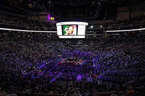 PHOTO: Mourners are seated before paying their respect at Kobe Bryant's and his daughter, Gigi's memorial service at Staple Center in Los Angeles, Feb. 24, 2020. (Etienne Laurent/EPA via Shutterstock)