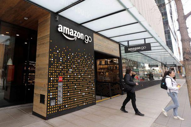 PHOTO: People walk out of an Amazon Go store in Seattle on March 4, 2020. An Amazon spokesperson said an employee who worked in a building on the company's campus in Seattle had tested positive for the novel coronavirus. (Ted S. Warren/AP)