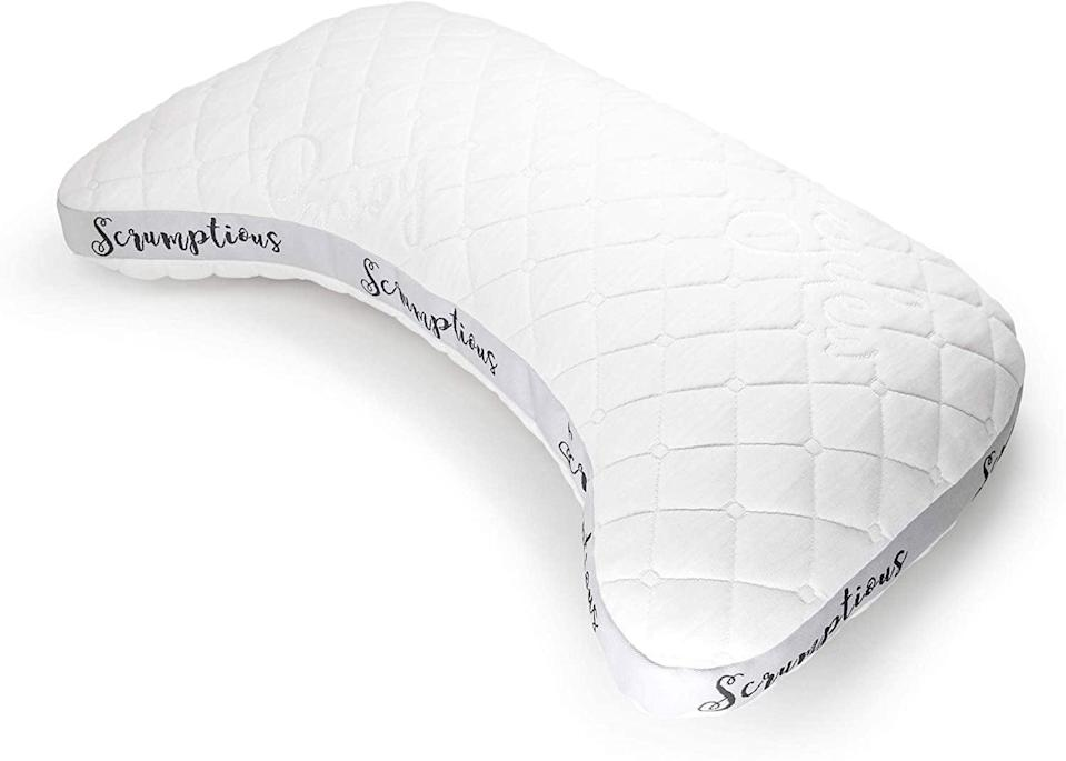 <p>The <span>Honeydew Side Sleeper Pillow</span> is a uniquely curve-shaped pillow that's not <em>just</em> for side sleepers. The cutout shape allows it to rest snugly around your bottom shoulder if you sleep on your side, but it also feels cozy around your neck if you sleep on your back. Rectangular-shaped pillows may not be the best for supporting your head and neck, which is why this side sleeper pillow offers such a great night of sleep. And the ribbon around the pillow isn't just for decorations - it's designed to maintain the shape of the pillow.</p>