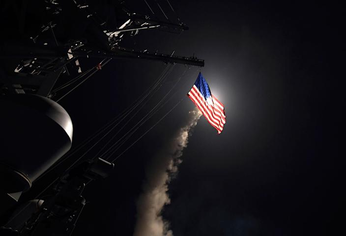 <p>The U.S. destroyer Porter launches a Tomahawk missile at a Syrian air base on April 7, 2017. (U.S. Navy via AP) </p>