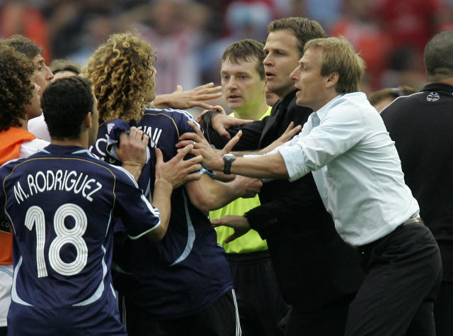 FILE - The June 30, 2006 file photo shows then German coach Juergen Klinsmann, right, and team manager Oliver Bierhoff, second from right, holding back Argentina player Fabricio Coloccini after Germany's 4-2 shootout win in the quarterfinal World Cup soccer match between Germany and Argentina at the Olympic Stadium in Berlin. On Sunday, July 13, 2014, Germany and Argentina will face each other again in the final of the 2014 soccer World Cup. (AP Photo/Thomas Kienzle, file)