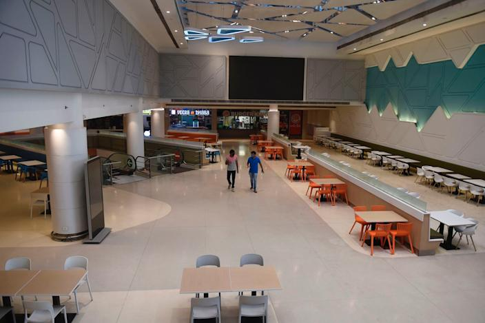 """A general view of a food court arranged to maintain social distance is seen at the Ahmedabad One Mall on June 7, 2020. <p class=""""copyright"""">Photo by SAM PANTHAKY/AFP via Getty Images</p>"""