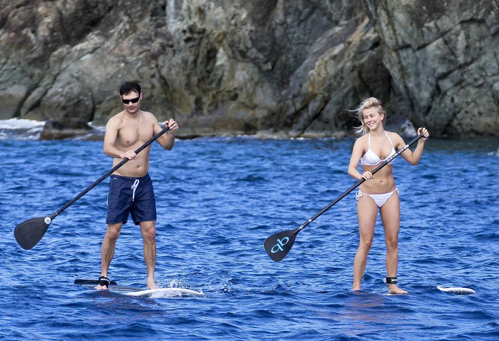 No laying around for these two! After helping America usher in the new year, Ryan Seacrest and girlfriend Julianne Hough slipped off for a warm-weather vacation in the Caribbean island of St. Barts. Taking advantage of the climate, they've been spending a lot of time in the great outdoors, including this paddleboard session in which their strokes appeared to be perfectly in sync. (1/2/2013)