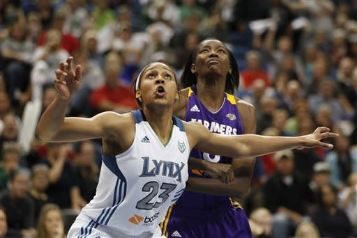 Minnesota Lynx forward Maya Moore (23) fights for rebound against Los Angeles Sparks forward DeLisha Milton-Jones (8) in the second half of Game 1 of the WNBA basketball Western Conference Finals Thursday, Oct. 4, 2012, in Minneapolis. Moore lead the Lynx with 20 as the Lynx won 94-77. (AP Photo/Stacy Bengs)