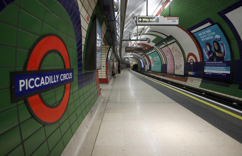 An empty platform at Piccadilly Circus tube station in London, Friday, March 20, 2020. For most people, the new coronavirus causes only mild or moderate symptoms, such as fever and cough. For some, especially older adults and people with existing health problems, it can cause more severe illness, including pneumonia. (AP Photo/Frank Augstein)