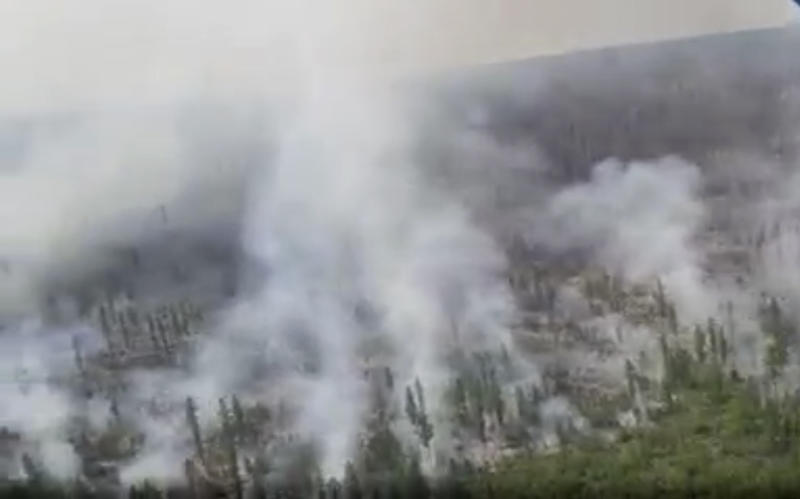 This image taken from video provided by Russian Emergency Ministry, shows a view of a forest fire in the Ust-Udinsky district of Krasnoyarsk region, Russia Far East, on Saturday, July 4, 2020. More than 2,000 hectares of forest were alight over a large area of the Russia's region, according to the ministry of emergency situations. (Russian Emergency Ministry via AP)