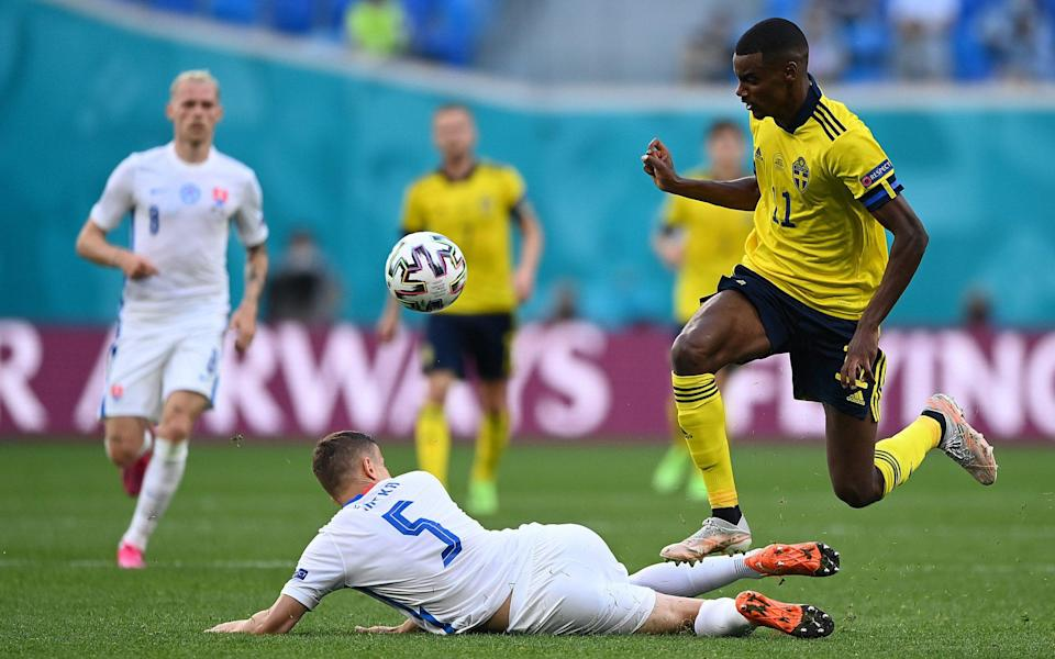 Alexander Isak of Sweden is challenged by Lubomir Satka of Slovakia during the UEFA Euro 2020 Championship Group E match between Sweden and Slovakia at Saint Petersburg Stadium on June 18, 2021 in Saint Petersburg, Russia. - GETTY IMAGES