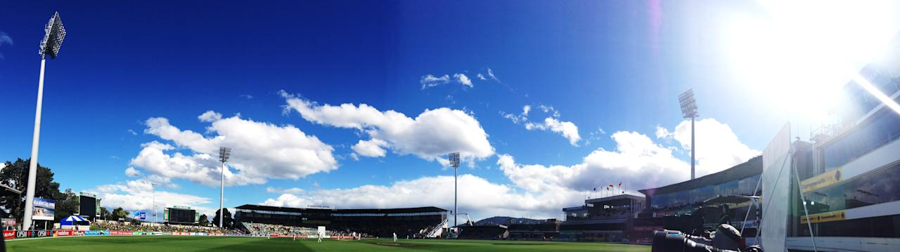 HOBART, AUSTRALIA - DECEMBER 16: (EDITORS NOTE: Image was created using a Panoramic feature on an iPhone camera.) A general view of play during day three of the First Test match between Australia and Sri Lanka at Blundstone Arena on December 16, 2012 in Hobart, Australia.  (Photo by Ryan Pierse/Getty Images)