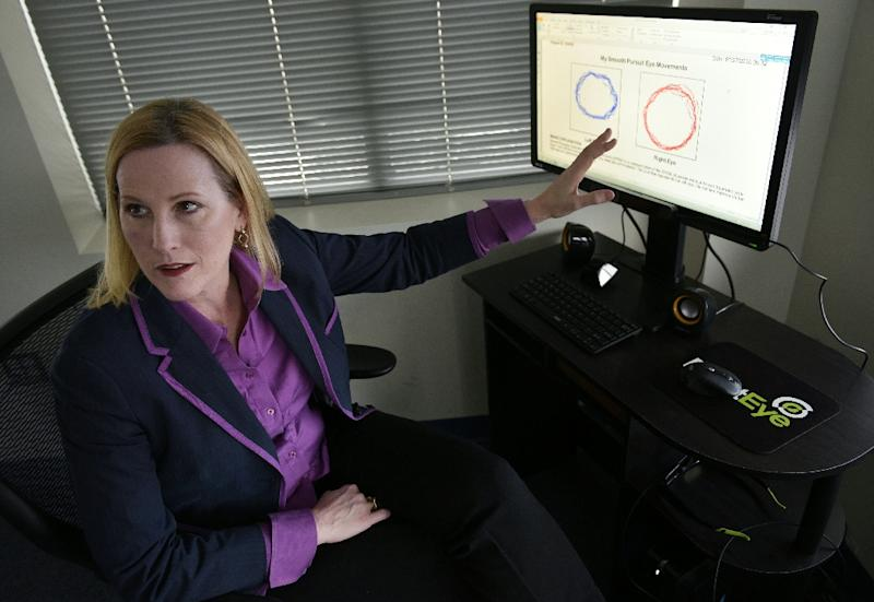 RightEye President demonstrates her company's eye-tracking technology at offices in Bethesda, Maryland (AFP Photo/Mandel Ngan)