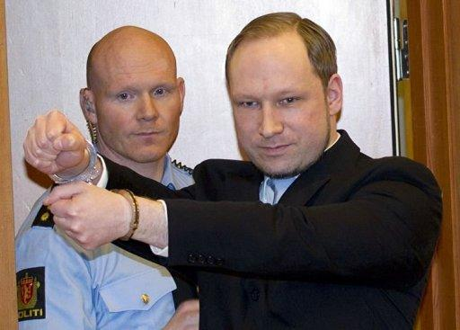 Anders Behring Breivik (R) arrives in court in Oslo in February