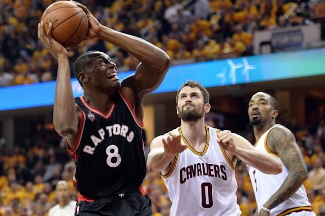 FILE PHOTO: May 17, 2016; Cleveland, OH, USA; Toronto Raptors center Bismack Biyombo (8) shoots as Cleveland Cavaliers forward Kevin Love (0) defends during the first quarter in game one of the Eastern conference finals of the NBA Playoffs at Quicken Loans Arena. Mandatory Credit: Ken Blaze-USA TODAY Sports / Reuters Picture Supplied by Action Images/File Photo *** Local Caption *** 2016-05-18T010106Z_1738041887_NOCID_RTRMADP_3_NBA-PLAYOFFS-TORONTO-RAPTORS-AT-CLEVELAND-CAVALIERS.JPG - MT1ACI14387431