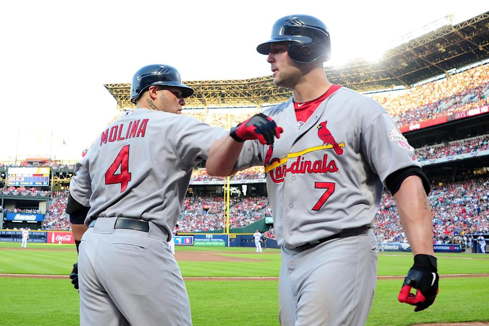 Matt Holliday #7 of the St. Louis Cardinals celebrates with Yadier Molina #4 after hitting a solo home run in the sixth inning against the Atlanta Braves during the National League Wild Card playoff game at Turner Field on October 5, 2012 in Atlanta, Georgia. (Photo by Scott Cunningham/Getty Images)