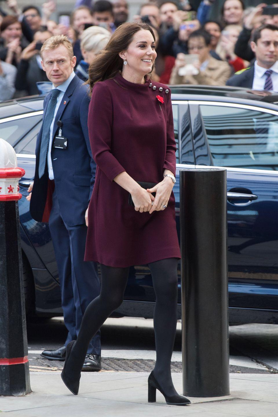 <p>In a plum mod dress with silver button accents by Goat, black tights, and black suede pumps at the annual Place2Be School Leaders Forum in London.</p>