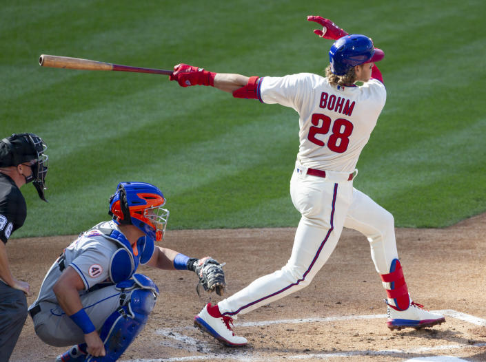 Philadelphia Phillies Alec Bohm (28) follows through on a home run during the first inning of a baseball game against the New York Mets, Wednesday, April 7, 2021, in Philadelphia. (AP Photo/Laurence Kesterson)