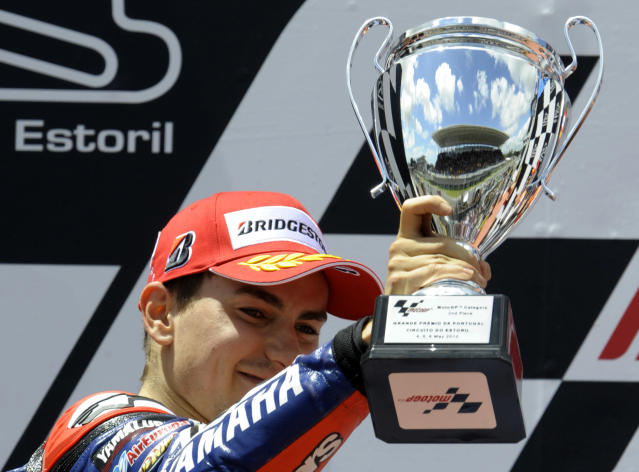Yamaha Factory Racing team's Spanish Jorge Lorenzo celebrates in the podium at the end of the Moto GP race of the Portuguese Grand Prix in Estoril, outskirts of Lisbon, on May 6, 2012. Repsol Honda Team's Casey Stoner won the race ahead Lorenzo and Repsol Honda team's Spanish Dani Pedrosa. AFP PHOTO / MIGUEL RIOPAMIGUEL RIOPA/AFP/GettyImages