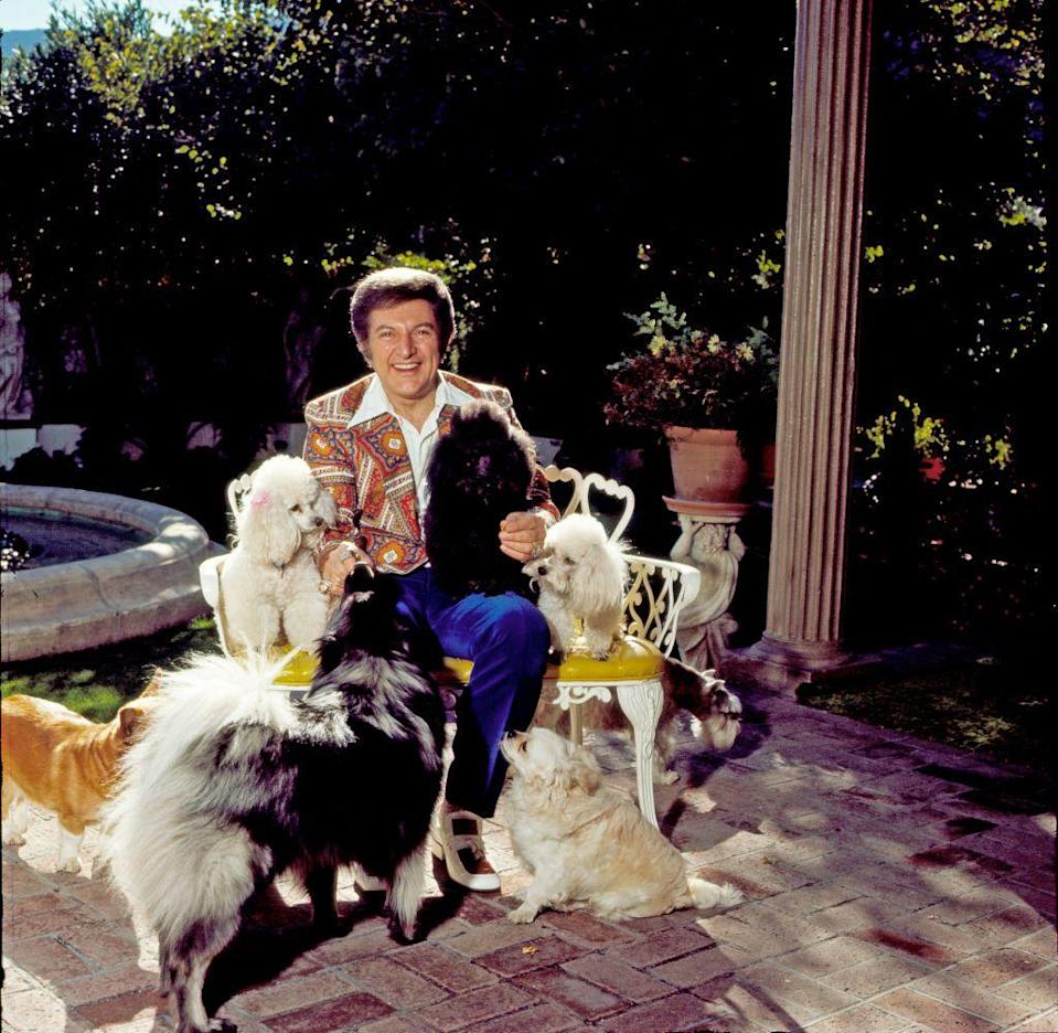 """<p>Emmy Award-winning performer Liberace poses alongside his beloved dogs at his Palm Springs estate in September 1980. </p><p><em><br></em></p><p><em><a href=""""https://subscribe.hearstmags.com/subscribe/womansday/253396?source=wdy_edit_article"""" rel=""""nofollow noopener"""" target=""""_blank"""" data-ylk=""""slk:Subscribe to Woman's Day"""" class=""""link rapid-noclick-resp"""">Subscribe to Woman's Day</a> today and get <strong>73% off your first 12 issues</strong>. And while you're at it, <a href=""""https://subscribe.hearstmags.com/circulation/shared/email/newsletters/signup/wdy-su01.html"""" rel=""""nofollow noopener"""" target=""""_blank"""" data-ylk=""""slk:sign up for our FREE newsletter"""" class=""""link rapid-noclick-resp"""">sign up for our FREE newsletter</a> for even more of the Woman's Day content you want.</em><br></p>"""