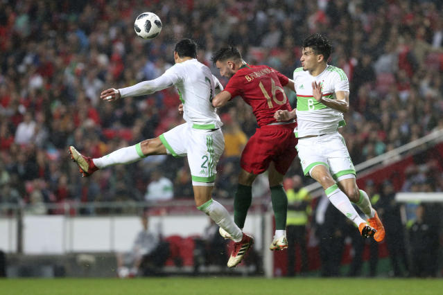 Portugal's Bruno Fernandes scores his first Portugal goal as his team advances 2-0 during a friendly soccer match between Portugal and Algeria in Lisbon, Portugal, Thursday, June 7, 2018. (AP Photo/Armando Franca)