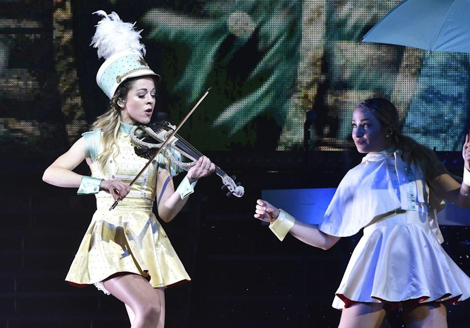 """<p>Violinist and YouTube star Lindsey Stirling plays a thrilling medley of """"We Three Kings,"""" """"God Rest Ye Merry Gentlemen"""" and """"Carol of the Bells.""""</p><p><a class=""""link rapid-noclick-resp"""" href=""""https://www.amazon.com/We-Three-Gentlemen-Medley/dp/B07GY2R9MQ?tag=syn-yahoo-20&ascsubtag=%5Bartid%7C10055.g.2680%5Bsrc%7Cyahoo-us"""" rel=""""nofollow noopener"""" target=""""_blank"""" data-ylk=""""slk:AMAZON"""">AMAZON</a> <a class=""""link rapid-noclick-resp"""" href=""""https://go.redirectingat.com?id=74968X1596630&url=https%3A%2F%2Fmusic.apple.com%2Fus%2Falbum%2Fwarmer-in-the-winter-deluxe-edition%2F1434569244&sref=https%3A%2F%2Fwww.goodhousekeeping.com%2Fholidays%2Fchristmas-ideas%2Fg2680%2Fchristmas-songs%2F"""" rel=""""nofollow noopener"""" target=""""_blank"""" data-ylk=""""slk:ITUNES"""">ITUNES</a></p>"""