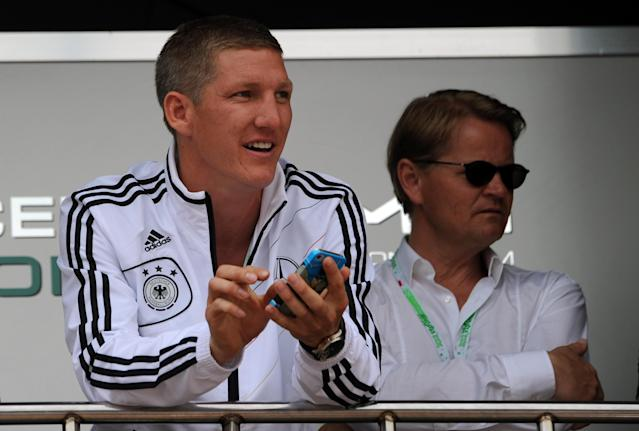 German national football team player Bastian Schweinsteiger is pictured during a visit to the Mercedes stand in the pits at the Circuit de Monaco on May 27, 2012 in Monte Carlo during the Monaco Formula One Grand Prix. AFP PHOTO / DIMITAR DILKOFFDIMITAR DILKOFF/AFP/GettyImages