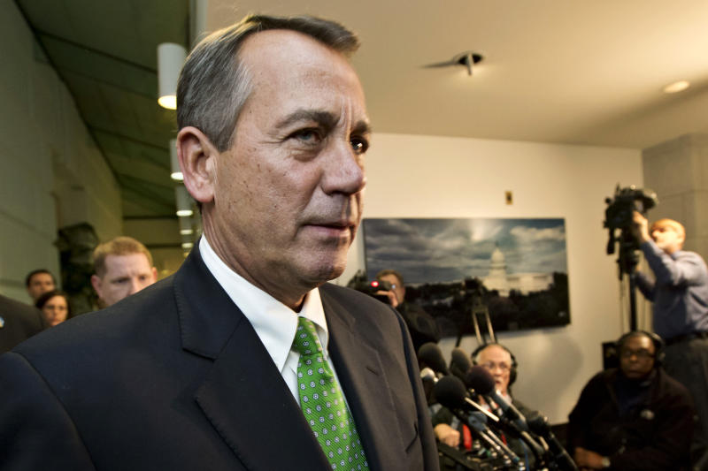 """FILE - In this Jan. 1, 2013, file photo, Speaker of the House John Boehner, R-Ohio, walks past reporters after a closed-door meeting meeting of House Republicans as the """"fiscal cliff"""" bill passed by the Senate the previous night waits for a vote in the GOP-controlled House at the Capitol in Washington. After Republicans and Democrats alike reluctantly shunned their core supporters and reached a bipartisan compromise to avert a fiscal crisis, there's a reasonable question to ask: Did American lawmakers actually _ for a moment, at least _ listen to the regular Joes and Janes pleading for a gridlocked Washington to get something, anything, done? (AP Photo/J. Scott Applewhite, File)"""