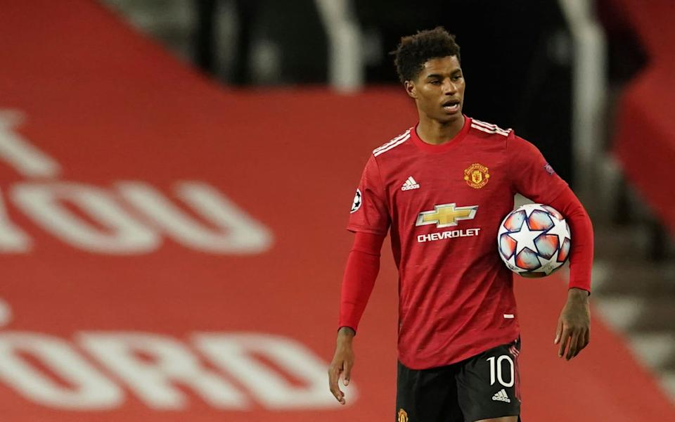The footballer Marcus Rashford has lobbied the UK Government over the issue - Dave Thompson/AP