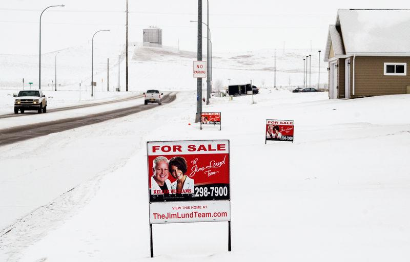 A sign advertises homes for sale in a new housing development in Dickinson