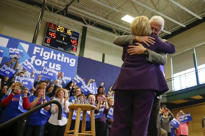 <p>The former president embraces his wife after introducing her at a campaign rally at Nashua Community College in Nashua, N.H., Feb. 2, 2016. <i>(Photo: Adrees Latif/Reuters)</i></p>