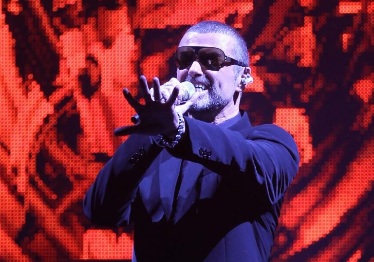 Late British singer George Michael performs on stage in the French city of Nice in September 2011