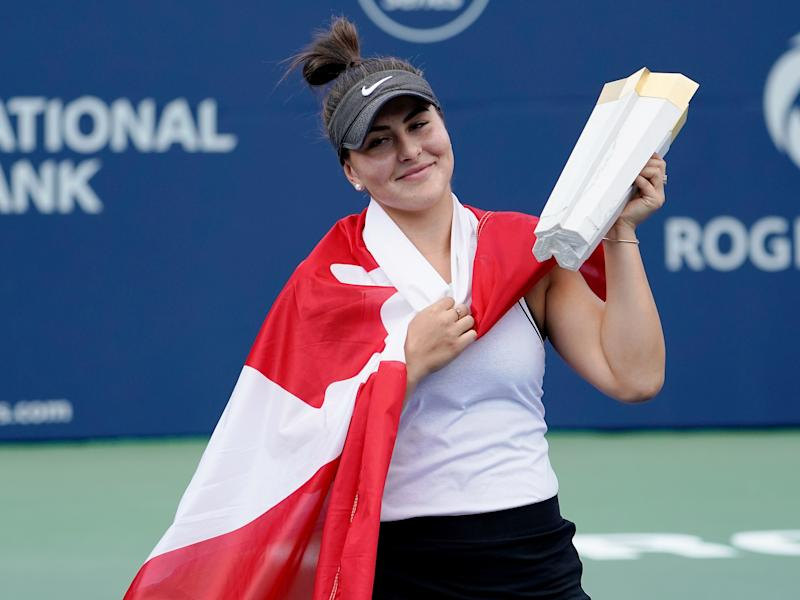 Aug 11, 2019; Toronto, Ontario, Canada; Bianca Andreescu (CAN) hoists the Rogers Cup trophy after defeating Serena Williams (not pictured) during the Rogers Cup tennis tournament at Aviva Centre. Mandatory Credit: John E. Sokolowski-USA TODAY Sports