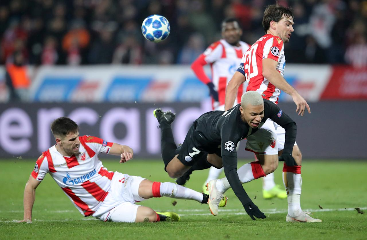 Soccer Football - Champions League - Group Stage - Group C - Crvena Zvezda v Paris St Germain - Rajko Mitic Stadium, Belgrade, Serbia - December 11, 2018  Paris St Germain's Kylian Mbappe in action with Crvena Zvezda's Milos Degenek and Filip Stojkovic    REUTERS/Marko Djurica     TPX IMAGES OF THE DAY