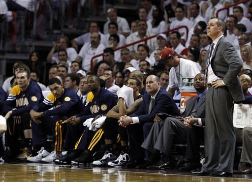 Indiana Pacers coach Frank Vogel, right, watches during the second half of Game 5 of the Pacers' NBA basketball Eastern Conference semifinal playoff series against the Miami Heat, in Miami on Tuesday, May 22, 2012. The Heat defeated the Pacers 115-83. (AP Photo/Lynne Sladky)