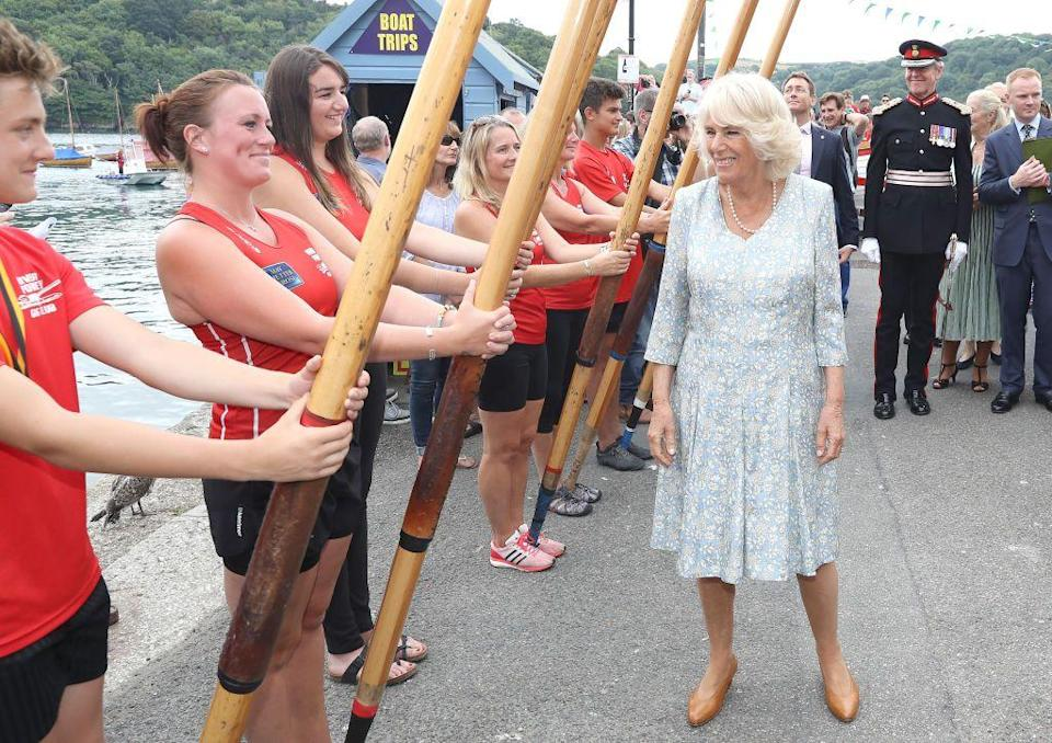 <p>The Duchess of Cornwall wore a blue-and-white floral dress with a pearl necklace and tan heels while attending the Fowey Festival Celebration during day one of their visit to Devon and Cornwall.</p>