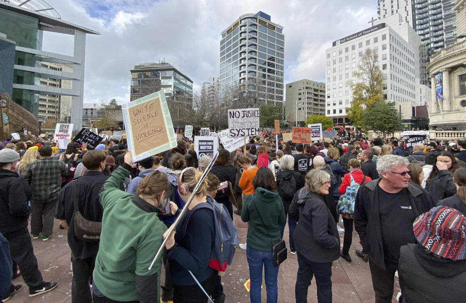 Protesters gather for the Black Lives Matter protest at Aotea Square, in central Auckland, New Zealand, Sunday June, 14, 2020. Thousands of New Zealanders turned out to protests Sunday in Auckland and Wellington. In Auckland, the protest began at the central Aotea Square and ended at the U.S. consulate, where protesters took a knee and observed a minute's silence to commemorate George Floyd, who died at the hands of Minneapolis police last month. (Courtney Winter/NZME via AP)