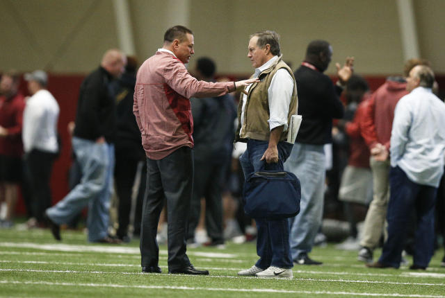 Former Tennessee coach Butch Jones talks with Patriots coach Bill Belichick during Alabama's Pro Day in March. Jones has officially been cleared to join Alabama's coaching staff. (AP Photo/Brynn Anderson)
