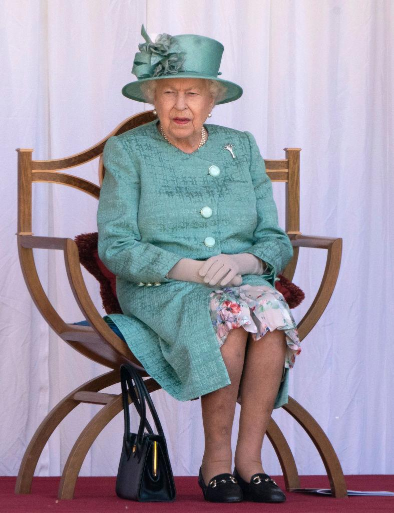 The Queen watches a military ceremony in the Quadrangle of Windsor Castle to mark Her Majesty's Official Birthday on Saturday 13th June, 2020.