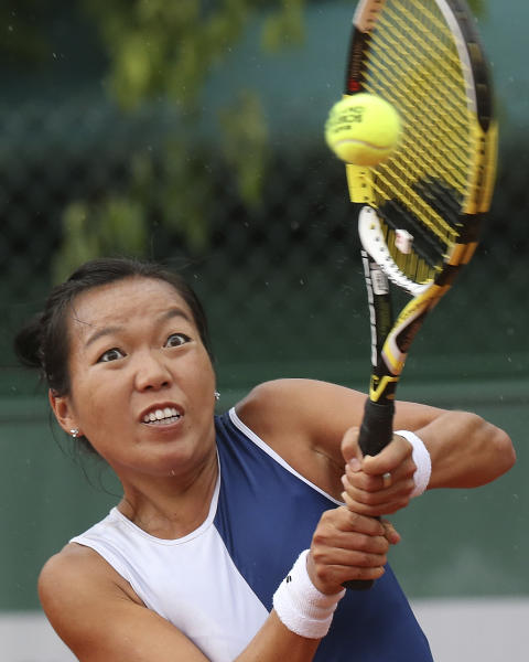 Vania King, of the U.S, returns the ball to compatriot Sloane Stephens during their second round match of the French Open tennis tournament at the Roland Garros stadium Thursday, May 30, 2013 in Paris. (AP Photo/Michel Euler)