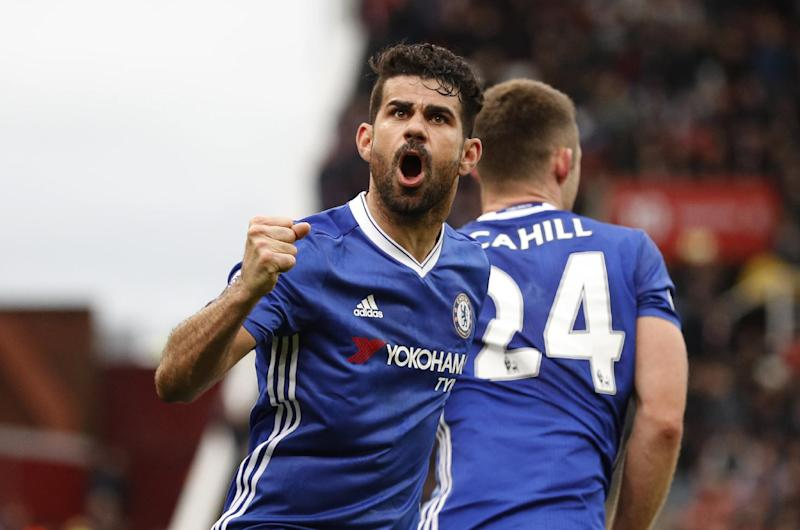 """Britain Football Soccer - Stoke City v Chelsea - Premier League - bet365 Stadium - 18/3/17 Chelsea's Gary Cahill celebrates with Diego Costa scoring their second goal  Reuters / Phil Noble Livepic EDITORIAL USE ONLY. No use with unauthorized audio, video, data, fixture lists, club/league logos or """"live"""" services. Online in-match use limited to 45 images, no video emulation. No use in betting, games or single club/league/player publications.  Please contact your account representative for further details."""