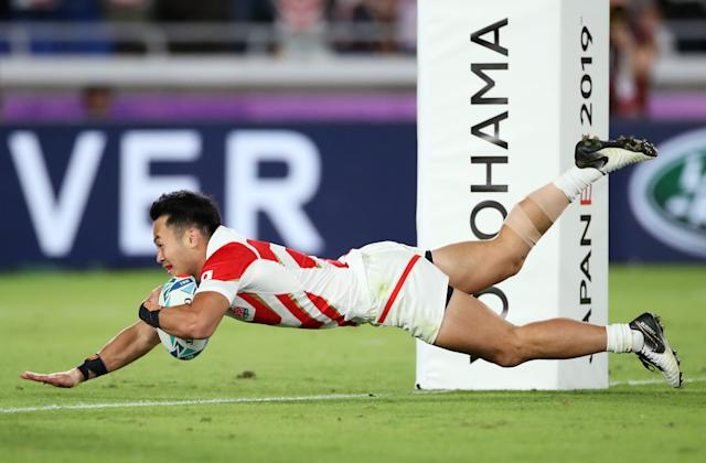 Fukuoka scores Japan's fourth try against Scotland. (Photo by Cameron Spencer/Getty Images)
