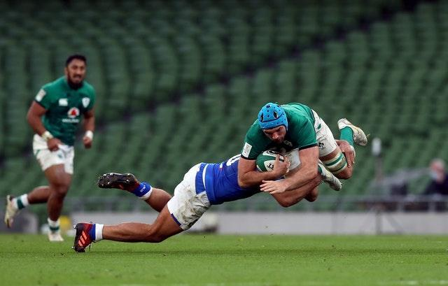 Tadhg Beirne, right, is tackled by Gianmarco Lucchesi