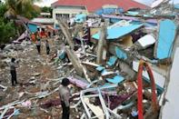 Many buildings, including hospitals, have been reduced to rubble; on Sunday police deployed sniffer dogs to help in the search for survivors and bodies