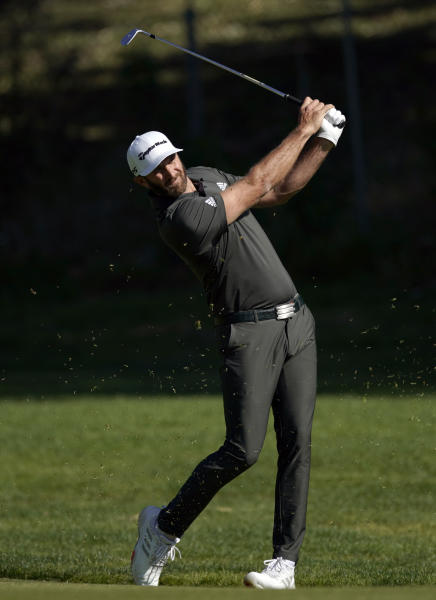 Dustin Johnson hits his second shot on the 12th hole during the final round of the Genesis Invitational golf tournament at Riviera Country Club, Sunday, Feb. 16, 2020, in the Pacific Palisades area of Los Angeles. (AP Photo/Ryan Kang)