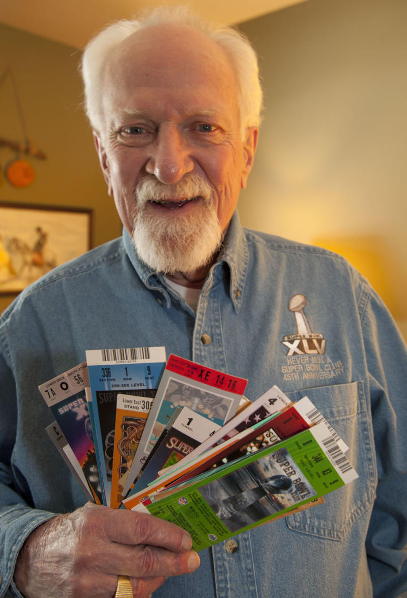 In this Jan. 12, 2011 photo, Bob Cook displays some of his Super Bowl ticket stubs in Brown Deer, Wis. Cook, one of the men featured in a Visa credit card television ad for having never missed a Super Bowl has died at age 79.  Although he wasn't able to make it to Texas, Cook watched from his Milwaukee area hospital bed as his beloved Green Bay Packers beat the Pittsburgh Steelers to win the 45th Super Bowl.  Cook died last week after a blood infection and other chronic issues, including congestive heart failure. (AP Photo/Jeffrey Phelps)