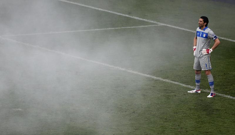 Italy goalkeeper Gianluigi Buffon looks to the smoke caused by flares during the Euro 2012 soccer championship Group C match between Italy and Croatia in Poznan, Poland, Thursday, June 14, 2012. (AP Photo/Anja Niedringhaus)